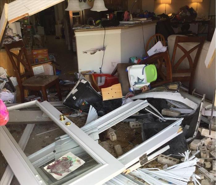SERVPRO Clean Up After a Motorist Drives Through Customer's Home Before